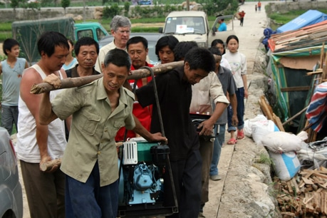The villagers of Yao Jin work hard to restore their community