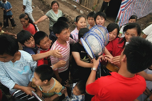 Operation Blessing distributed badminton rackets to children in Yang Yim.