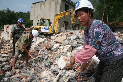 Villagers help Operation Blessing workers remove the debris in Yao Jin.