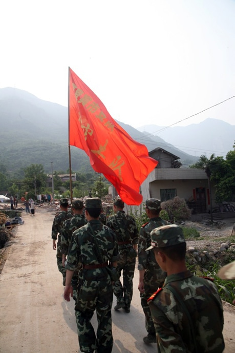 There was a troop of military men in Yao Jin setting up tents and helping with odd jobs in the village.