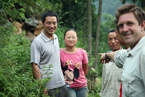 Mu Li asked us to help take her heavy water collection jugs up to the next village 1.5 miles away.