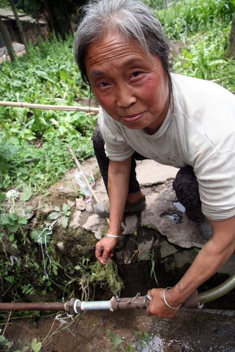 Operation Blessing works to restore the village's water supply.