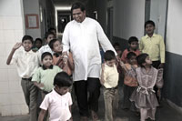 Two years after opening his center in Hyderabad, Father Raj (center) cares for 20 orphans—and hopes to eventually take in 50 children.