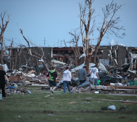 Residents sift through the remains of their homes.