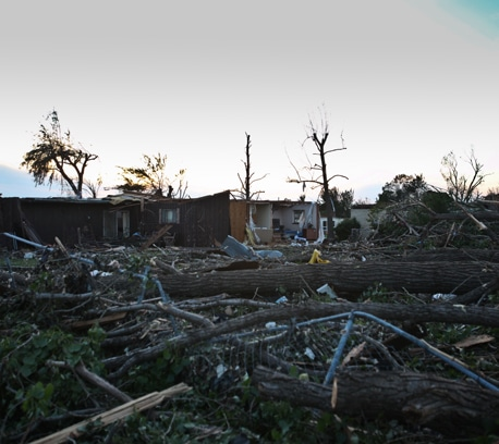 Dusk settles over a devastated neighborhood in Joplin.