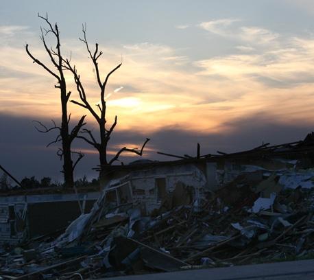 Sun fades over destruction in Joplin, Missouri.