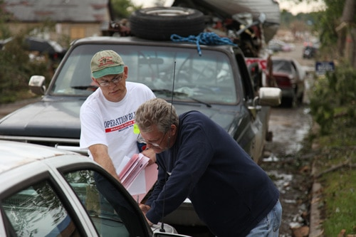 Joplin resident fills out work order with Operation Blessing disaster relief teams.
