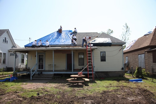An Operation Blessing disaster relief team tarps Randy's roof.