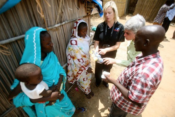 OBI Israel director, Charmaine Hedding, and OBI President Bill Horan help distribute medicine to Nuba refugees in South Sudan