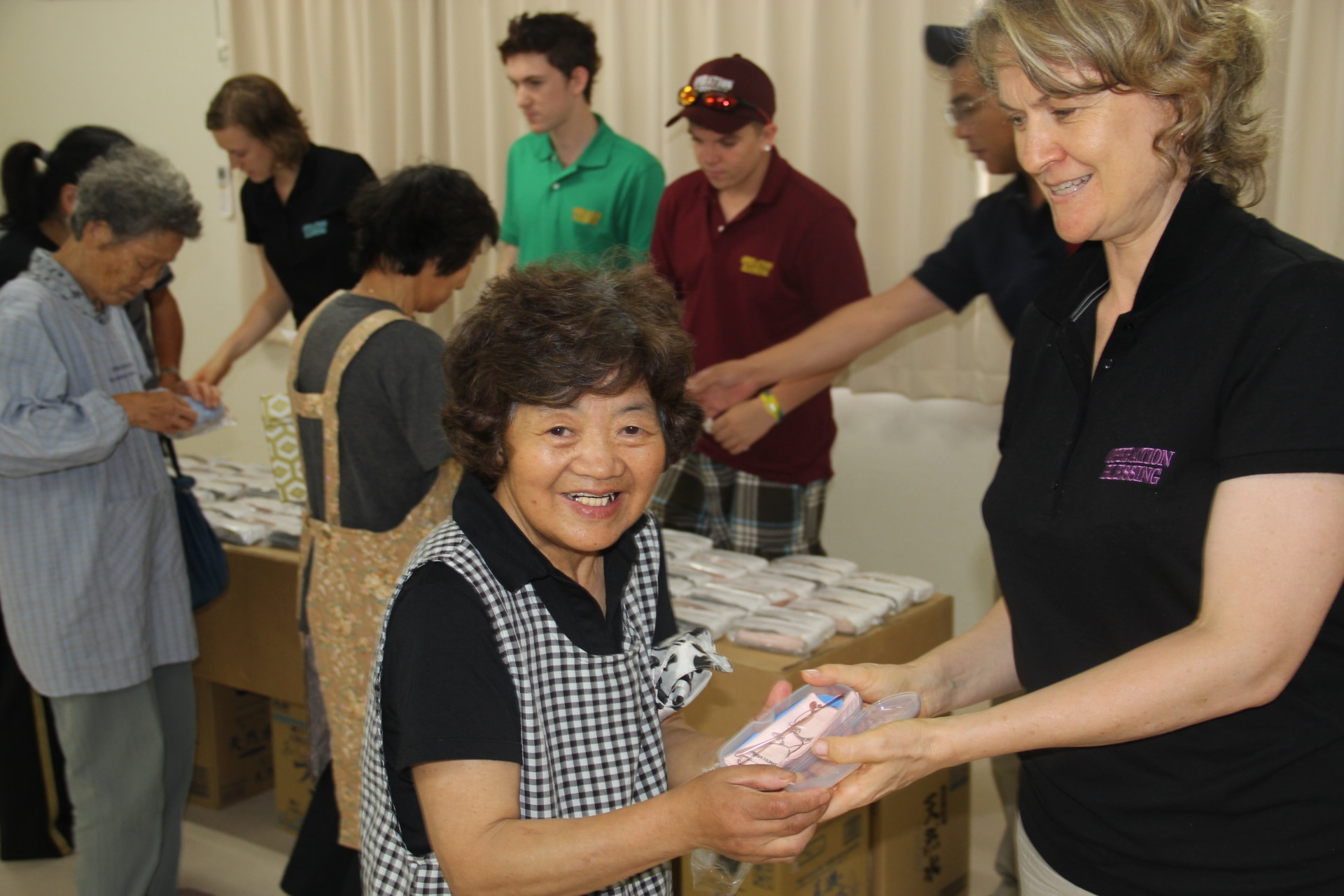 A woman in Japan receives her new prescription glasses after the tsunami.