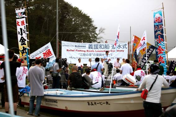 OBI presents new boats to fishermen in Japan after the tsunami.