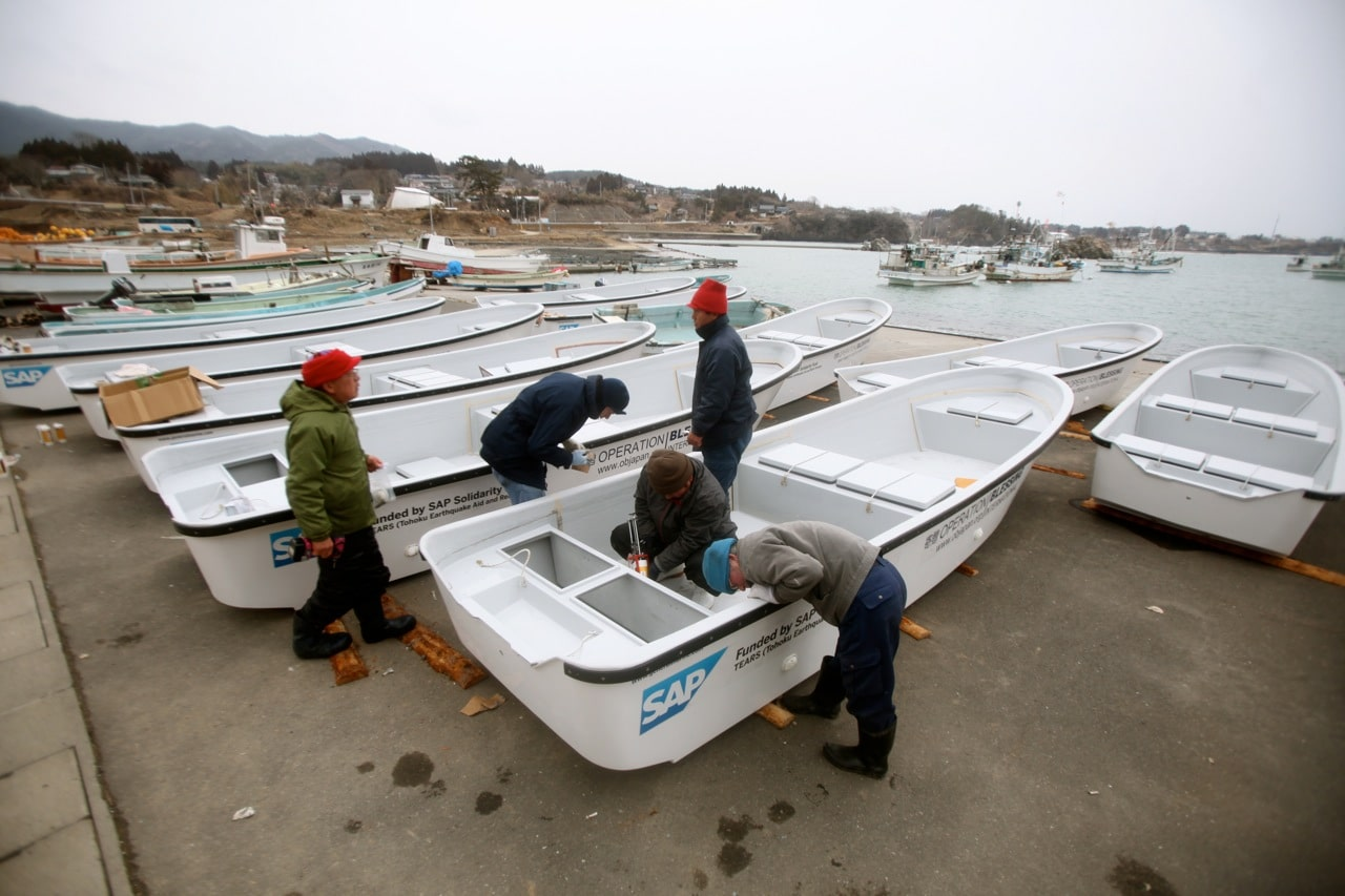 Prepping the fishing boats for the special one-year anniversary ceremony.