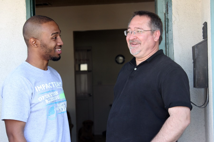 Tyree and Jerry talk as the Impact Team works to bless this family.