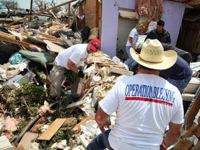 OBI volunteers help salvage items from a tornado-devastated home in Granbury, Texas.