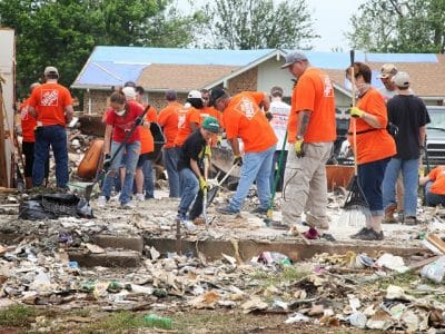 Home Depot and Operation Blessing volunteers spent the day cleaning up debris, tarping roofs and helping residents salvage personal belongings from the rubble.