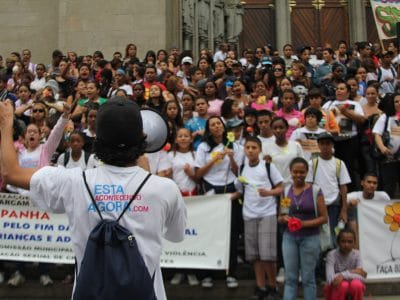 Youth in Brazil march to end child abuse.