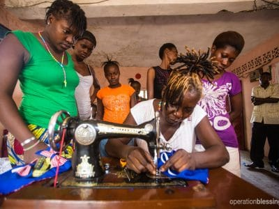 Thanks to Miss Bea's sewing school, these young women are learning a marketable skill.