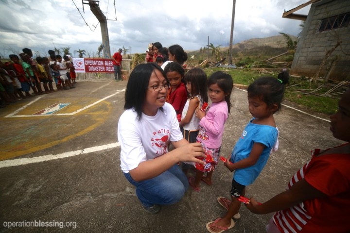 OBI teams give special treats to put smiles on the faces of children living in typhoon-devastated communities.