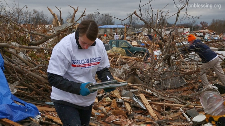 OBI volunteers search through rubble to help Illinois residents salvage belongings.