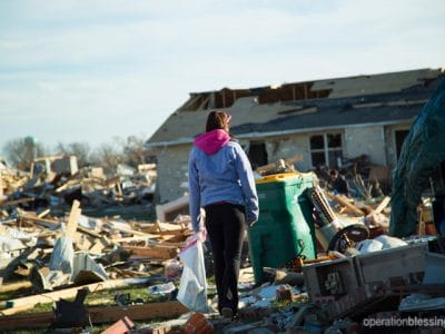 An Illinois resident searches through the rubble to find salvageable items.