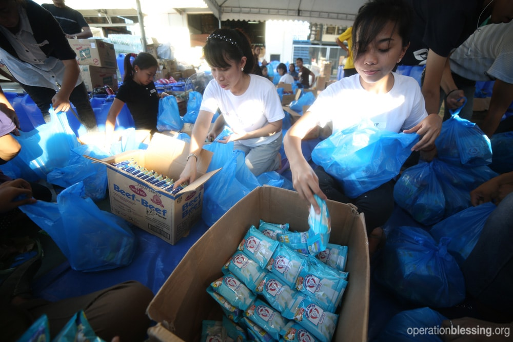 Operation Blessing teams pack relief kits
