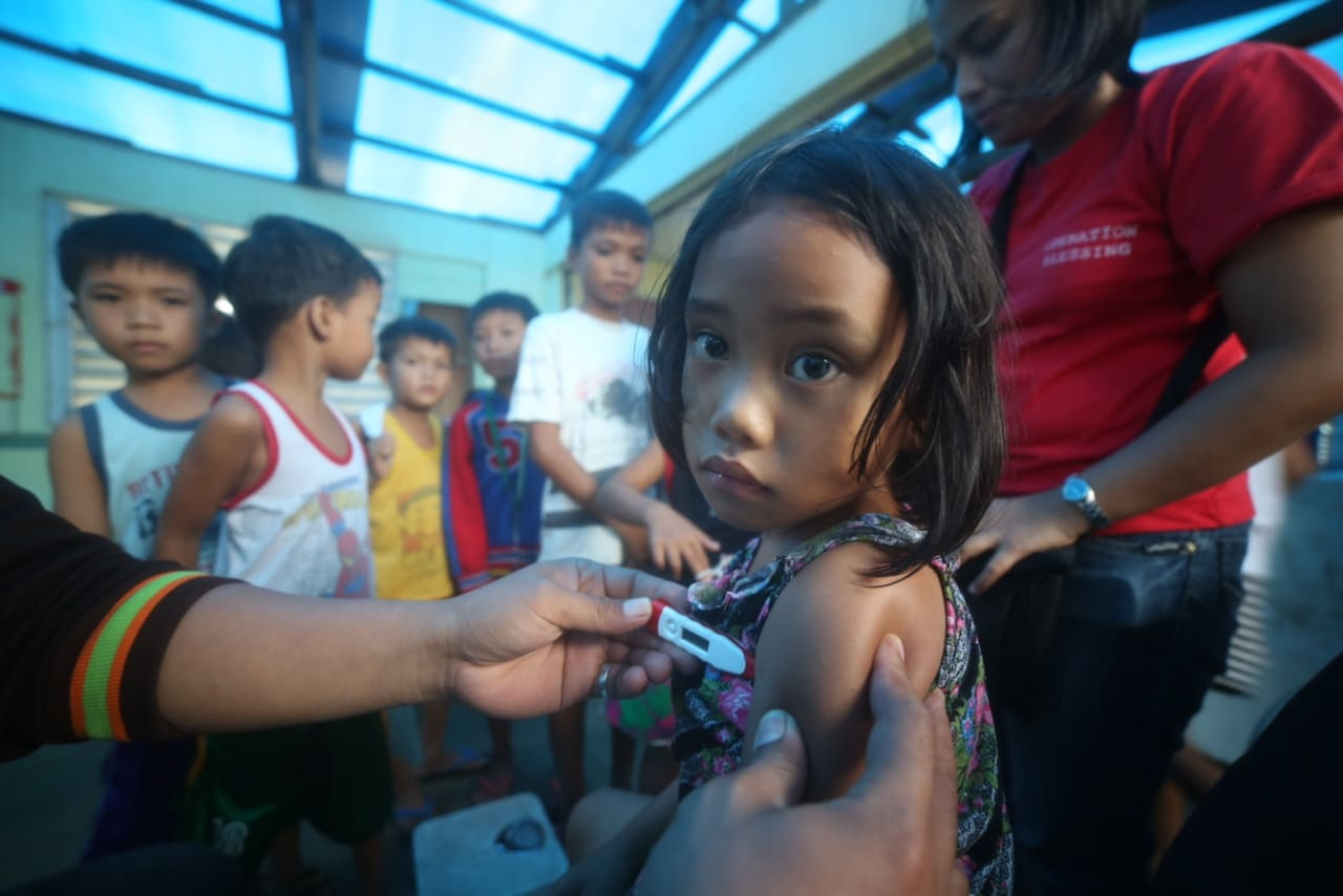 Children receive medical and dental care in the Philippines