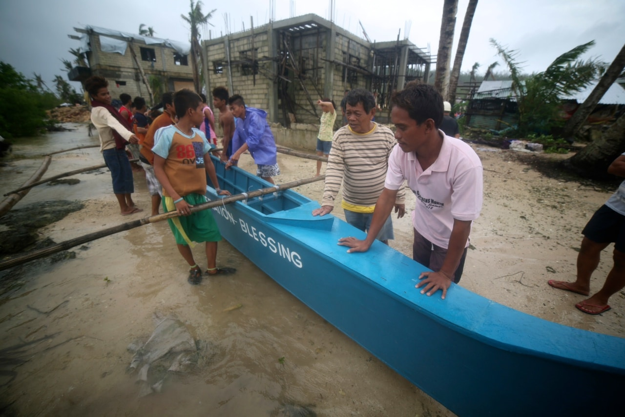 Fishing boats help families recover from Typhoon Haiyan