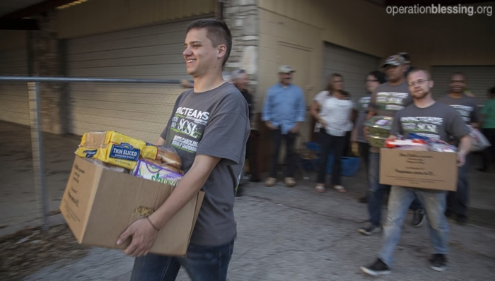 Students deliver boxes of food to families in need