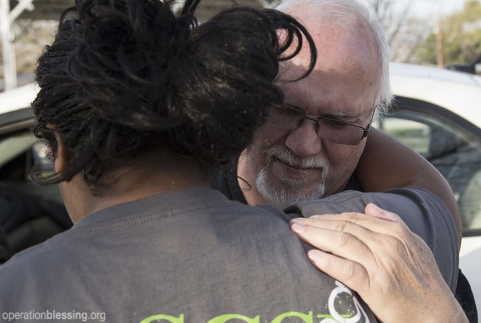 Dick receives food and encouragement from Operation Blessing volunteers