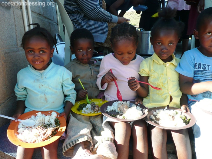 Children in Lesotho receive a healthy meal
