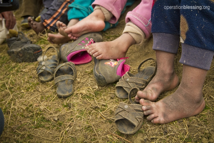 Children living in this impoverished region suffer from the cold and frostbite because they do not have proper shoes to protect their feet.
