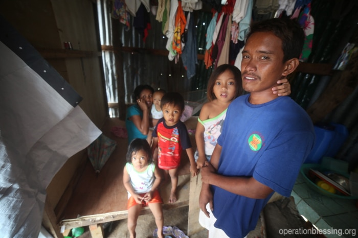 Waldo and his family living in a makeshift shelter