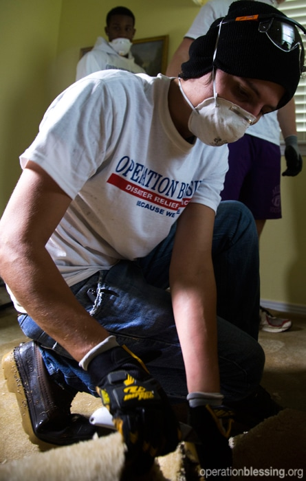 Operation Blessing teams help remove flood-soaked flooring