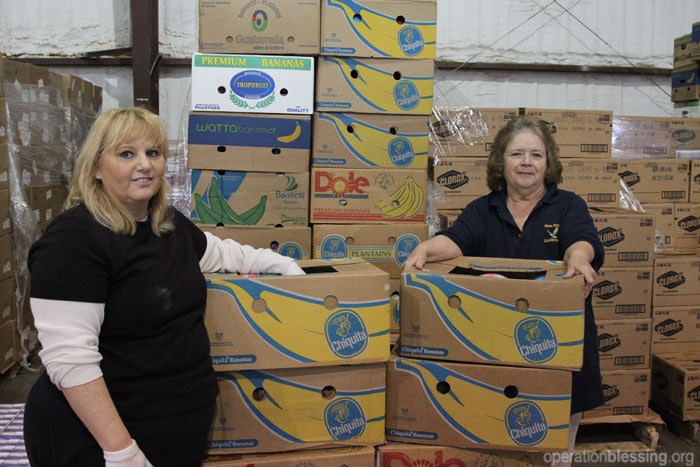 A family facing hunger receives help in their time of need from a local food distribution center supported by Operation Blessing