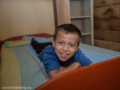 Now, seven-year-old Cristian doesn't have to leave when it rains