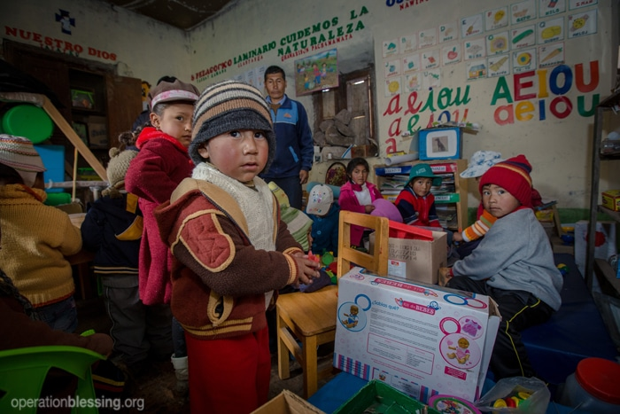 Operation Blessing teams deliver TOMS Winter Boots to school children in the highlands of Peru