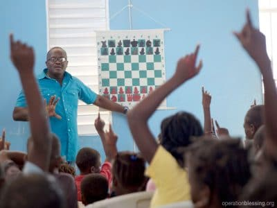 A group of students in Haiti learn more than just chess from a special Operation Blessing program