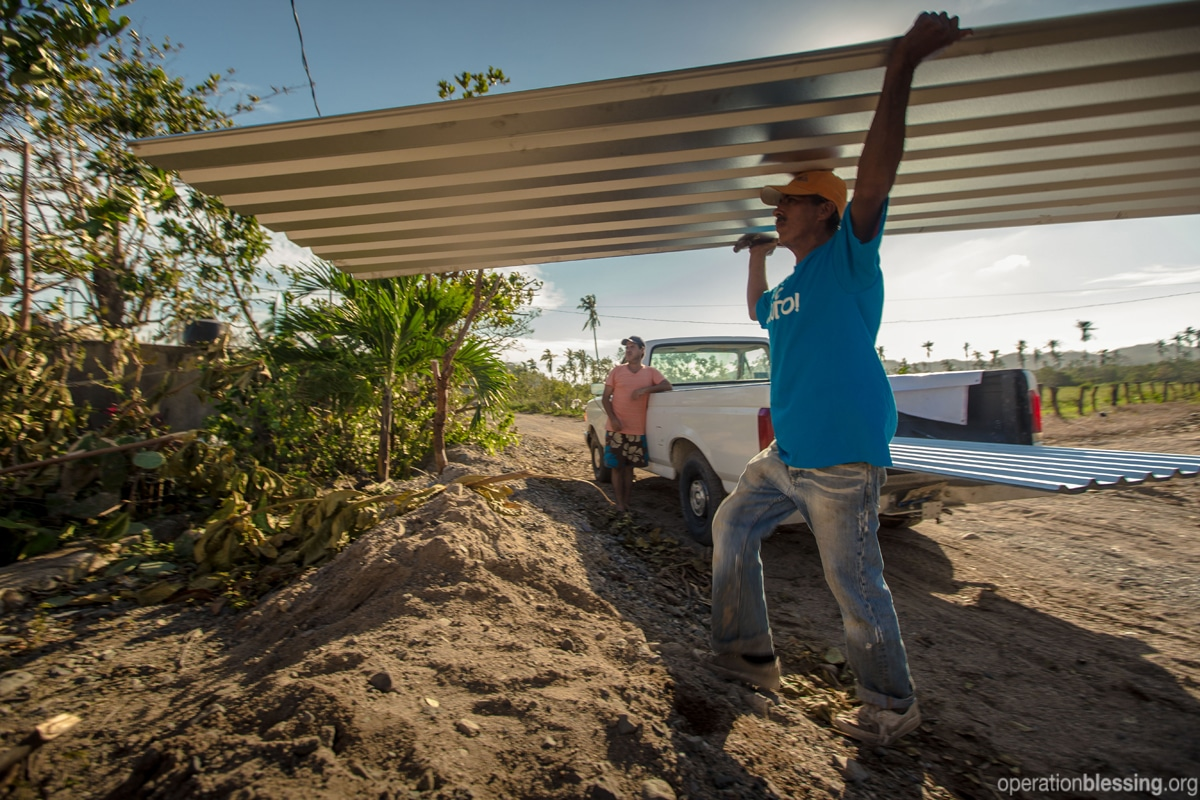 New roof pieces help create safe shelter for Maria and Sara.