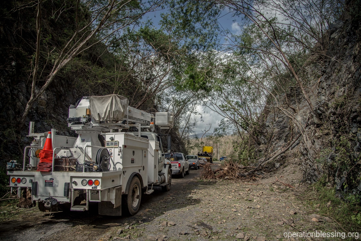 Disaster relief teams make their way through the devastation