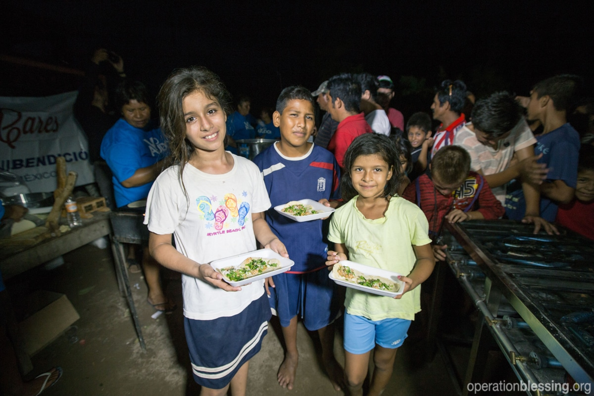 Children receive a hot meal