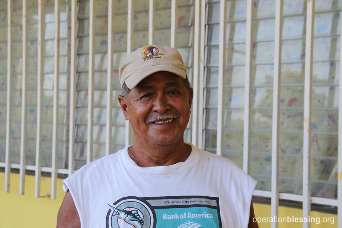 Jose smiles, happy that the free medication he receives is helping his blood pressure.