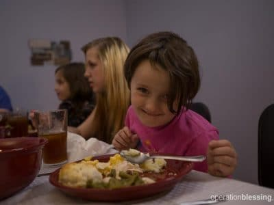 Delilah eats a nutritious meal with her family.