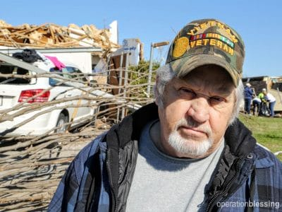 Donald stands in front of the wreckage after the Texas tornado