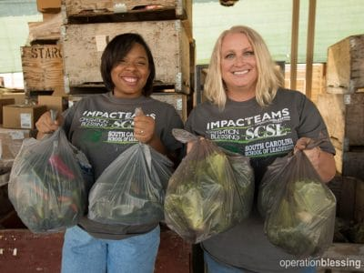 Impact team members make an impact on hunger at the Heart of Compassion ministry.