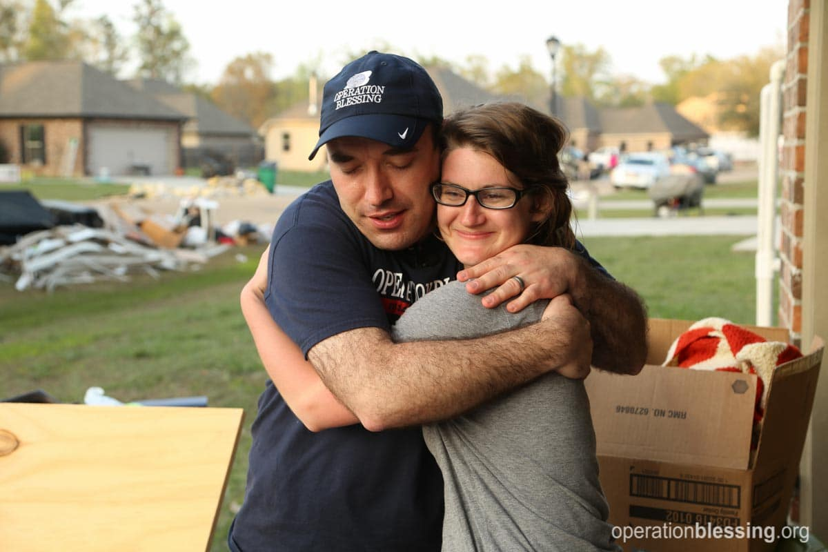 Kaycee hugs Operation Blessing staff member Dan Moore, thankful for the help her family received after the Louisiana floods.