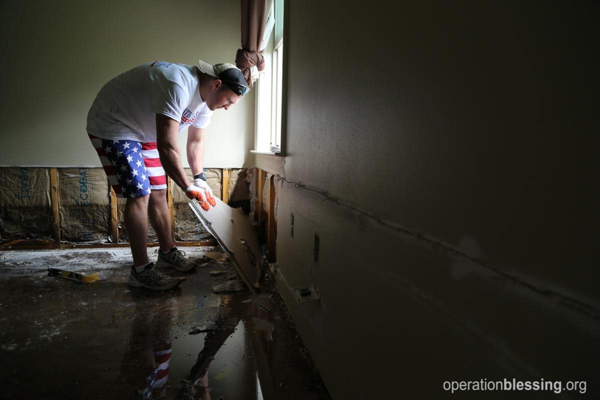 The drywall had to be cut above the waterline after a foot of water flooded Kaycee and Kyle's Louisiana home.