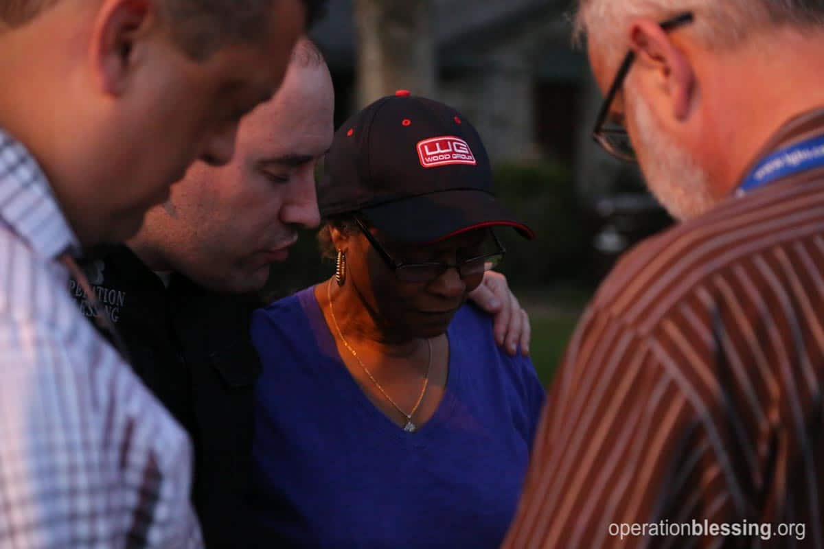 Praying with a disaster victim after flooding in Texas