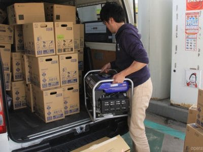 OB Japan packs a truck with relief supplies after earthquake hits.