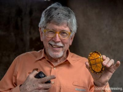 OBI President Bill Horan with a turtle that will fight the Zika virus