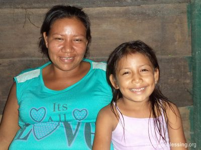 Maribel is thankful to be alive as she sits with one of her daughters.